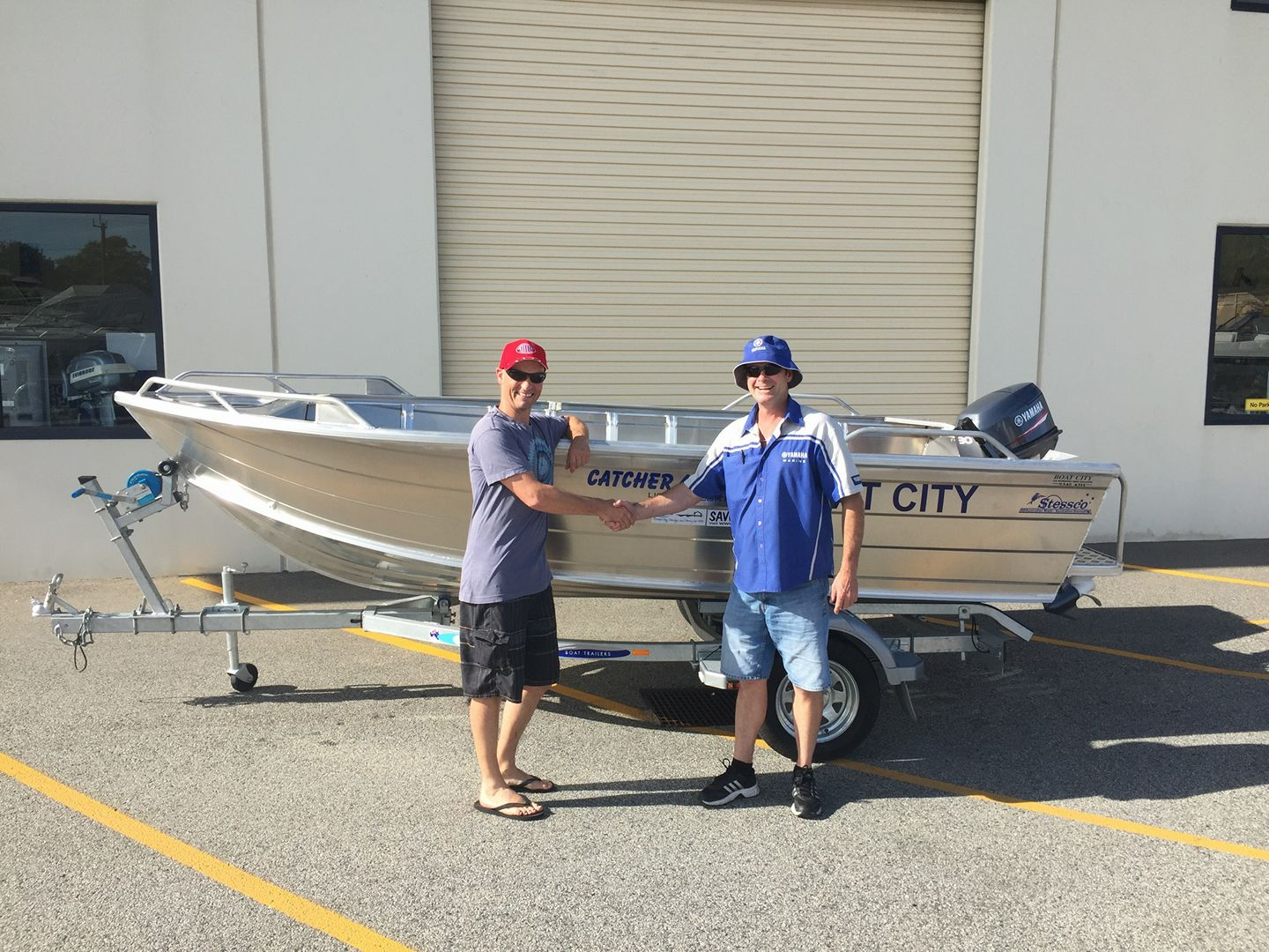 Boat raffle winner Scott Cox picking up his prize boat from Boat City